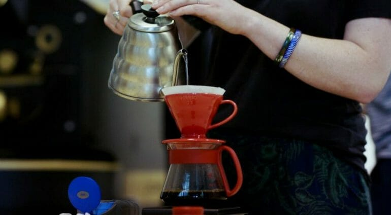 pouring water with a kettle over a Hario V60
