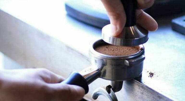 Tamping coffee in an espresso portafilter