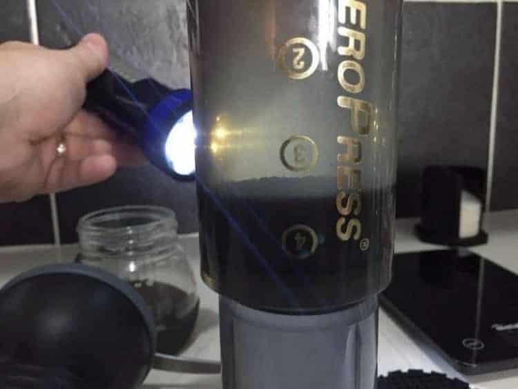 Aeropress showing coffee inside