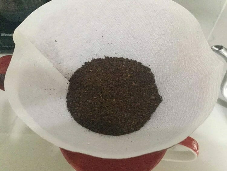 Ground coffee added to paper filter