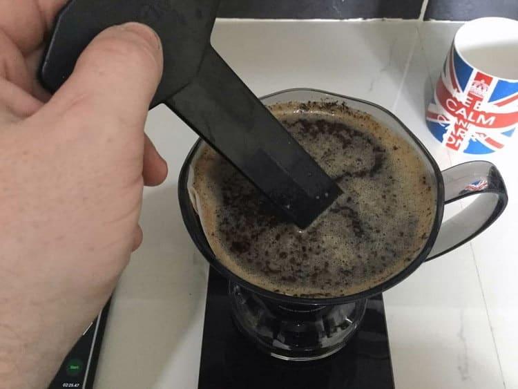 Stirring coffee grounds