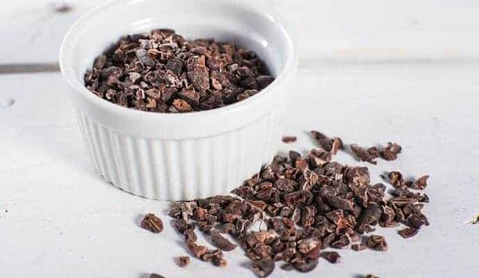 ceramic dish containing Cocoa Nibs