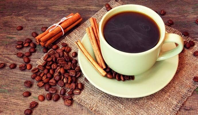 cup of black coffee and whole Cinnamon