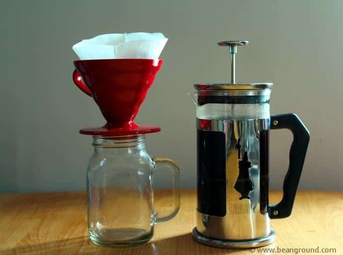 French Press and a red V60 coffee dripper on top of a mason jar