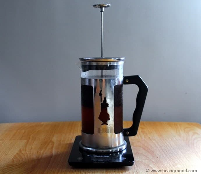 French Press stood on a wooden table