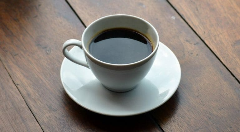 black Americano coffee on a wooden table