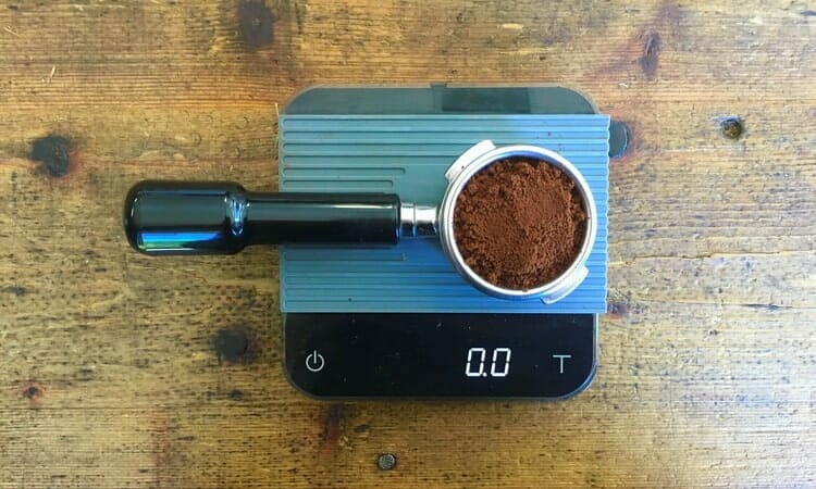 weighing coffee for a double espresso shot